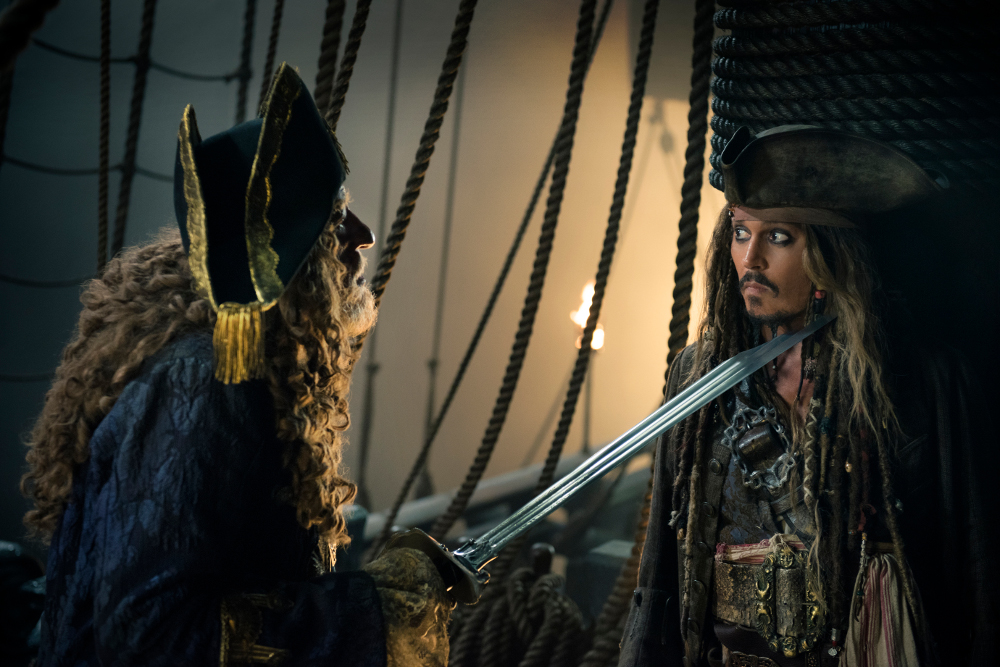 """PIRATES OF THE CARIBBEAN: DEAD MEN TELL NO TALES"" The villainous Captain Salazar (Javier Bardem) pursues Jack Sparrow (Johnny Depp) as he searches for the trident used by Poseidon Pictured L-R: Geoffrey Rush (Barbossa) and Johnny Depp (Captain Jack Sparrow) Ph: Peter Mountain © Disney Enterprises, Inc. All Rights Reserved."