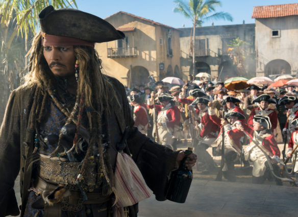 """""""PIRATES OF THE CARIBBEAN: DEAD MEN TELL NO TALES""""  The villainous Captain Salazar (Javier Bardem) pursues Jack Sparrow (Johnny Depp) as he searches for the trident used by Poseidon  Pictured: Johnny Depp (Captain Jack Sparrow)  Ph: Peter Mountain  © Disney Enterprises, Inc. All Rights Reserved."""